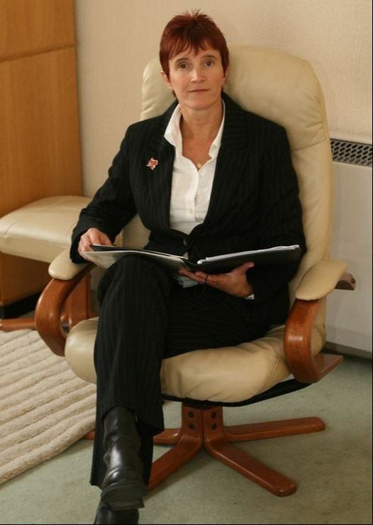Picture Becky Wells Hypnotherapist on an chair
